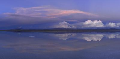 Clouds reflected on the Uyuni Salt Flats in Bolivia. by Raul Touzon