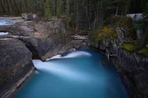 Kicking Horse River at the Natural Bridge in Yoho National Park by Raul Touzon