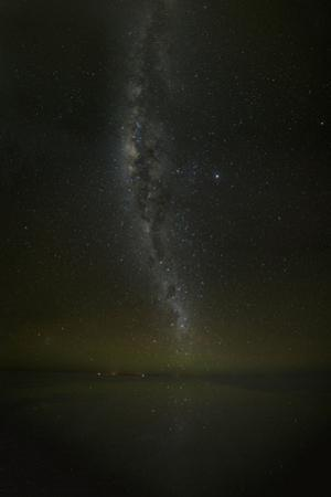 Milky way reflected on the Uyuni Salt Flats at night in Bolivia. by Raul Touzon