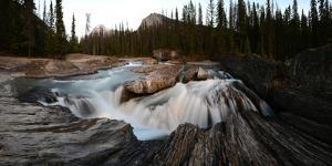 Natural Bridge over Kicking Horse River in Yoho National Park by Raul Touzon