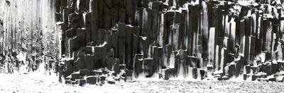 Panorama Image of Basalt Columns in Seashore Covered in Snow by Raul Touzon