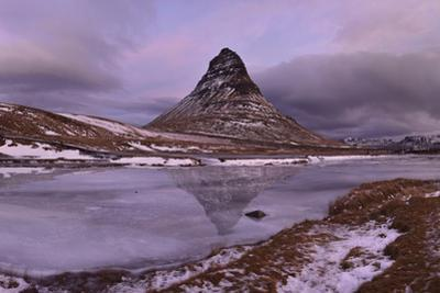 Panorama Image of Mount Kirkjufell Reflected on Ice by Raul Touzon