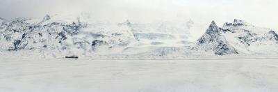 Panorama Image of Mountain Range and Glacier Toungues Covered in Snow by Raul Touzon