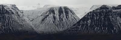 Panorama Image of Mountain Range Covered in Snow by Raul Touzon