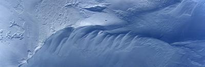 Panorama image of wind swept snow on top of Vatnajokull glacier. by Raul Touzon