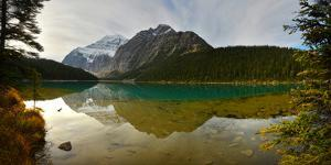 Reflection of Canadian Rockies on Edith Lake by Raul Touzon
