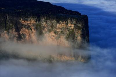Roraima, the Tallest Tepui, Rises from the Clouds at Sunrise by Raul Touzon