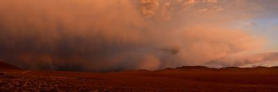 Sand storm over the Siloli Desert at sunset. by Raul Touzon