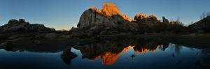 Sandstone Formations and Boulders at Sunset in Joshua Tree National Park by Raul Touzon