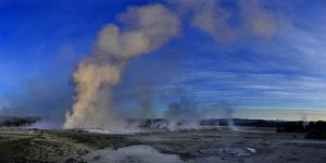 Steam Rises from Erupting Geysers Lower Geyser Basin by Raul Touzon