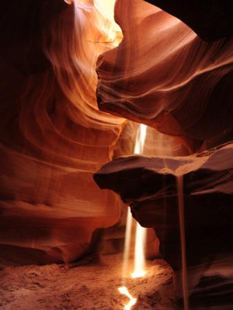 Sunlight and Shadows in a Cave at Antelope Pass by Raul Touzon
