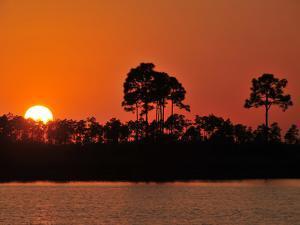 Sunset at Pine Glades Lake by Raul Touzon