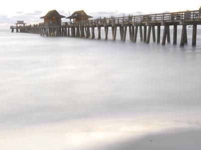 The Fishing Pier at Naples Beach by Raul Touzon