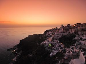 The Hillside Town of Oia at Dusk by Raul Touzon