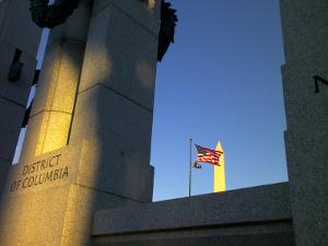 The World War II Memorial, a U.S. Flag and the Washington Monument by Raul Touzon