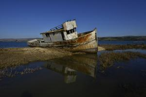 The Wreck of a Fishing Boat by Raul Touzon