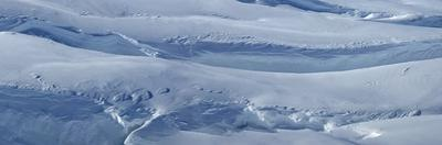 Windswept snow at Vatnajokull glacier in Iceland. by Raul Touzon