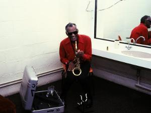 Ray Charles with His Alto Saxophone Backstage