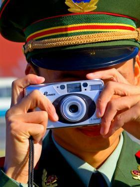 Guard Using His Camera on National Day in Tiananmen Square, Beijing, China by Ray Laskowitz