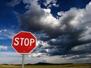 Stop Sign on Plains with Clouds Above by Ray Laskowitz