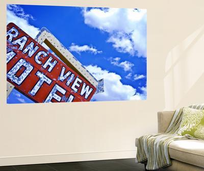 Weather-Beaten Sign of Roadside Hotel by Ray Laskowitz