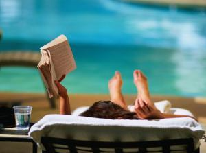 Woman Reading by Hotel Swimming Pool, Las Vegas, Nevada, USA by Ray Laskowitz