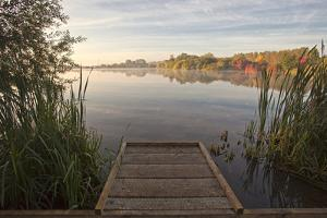 Autumnal Sunrise across the Lake by Ray Wise