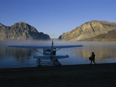A Seaplane Gets Ready for Take off from the Shoreline of Cli Lake