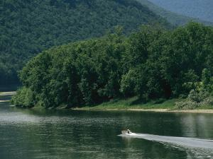 A Small Motorboat on the Susquehanna River Near the Endless Mountains by Raymond Gehman