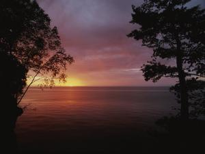 A Sunset over Lake Superior in the Apostle Islands by Raymond Gehman