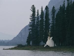 A Tepee is Built on the Edge of Cli Lake by Raymond Gehman