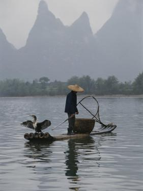 Cormorant Fisherman on the Li River by Raymond Gehman