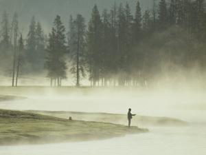 Fishermen in the Morning Mist on the Madison River by Raymond Gehman