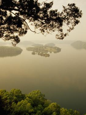 Foggy Sunrise over Dale Hollow Lake by Raymond Gehman