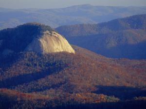 Looking Glass Rock, Surrounded by Forested Hills in Autumn Hues by Raymond Gehman