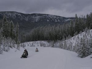 Snowmobilers in Yellowstone National Park, Wyoming by Raymond Gehman