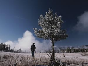 Steam Rises Behind a Man in a Frost-Covered Pocket Basin Field by Raymond Gehman