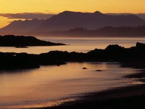 Sunset on the Mountains and Water at Long Beach on Vancouver Island by Raymond Gehman
