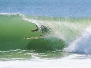 Surfer Shoots the Curl, Cape Hatteras National Seashore, North Carolina by Raymond Gehman