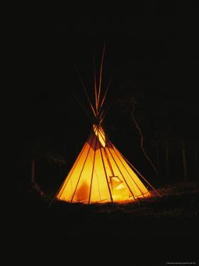 The Glow from a Campfire Makes a Shadow on a Tepee by Raymond Gehman