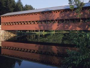 The Sachs Mill Bridge is Reflected in the Marsh River by Raymond Gehman