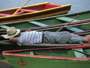 Tour Boat Guide Naps in Rowboats on Li River, Guilin, Guangxi, China by Raymond Gehman