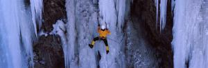 Rear View of a Person Ice Climbing, Colorado, USA