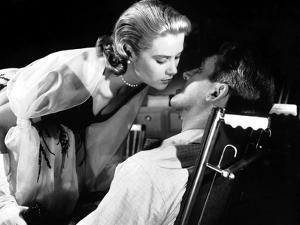 REAR WINDOW, 1954 directed by ALFRED HITCHCOCK Grace Kelly and James Stewart (b/w photo)