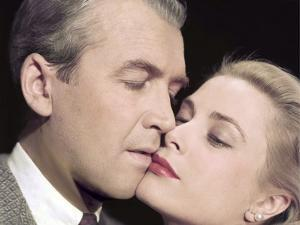 REAR WINDOW, 1954 directed by ALFRED HITCHCOCK James Stewart and Grace Kelly (photo)