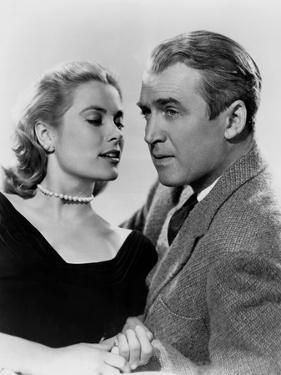 REAR WINDOW, 1954 directed byALFRED HITCHCOCK Grace Kelly and James Stewart (b/w photo)