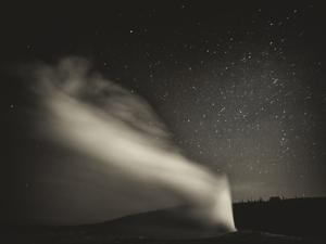 Old Faithful Geyer after Dark at Yellowstone National Park by Rebecca Gaal