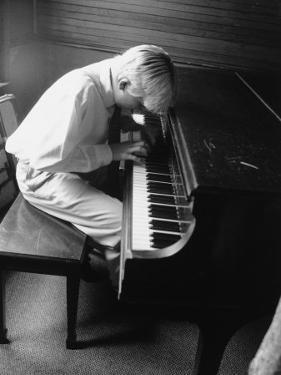 Boy Playing the Piano by Rebecca Marvil