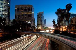 Los Angeles Skyline and Freeway at Night by rebelml