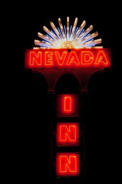 "Red neon sign saying ""Nevada Inn"""